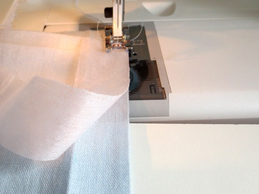 Sew interfacing to right side of center front using a 1/4 inch seam.