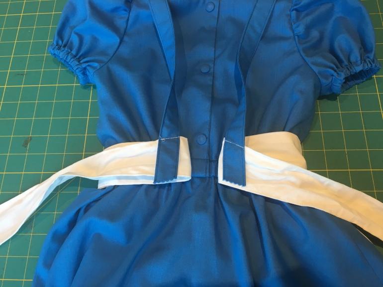 13 Sew back straps to sash